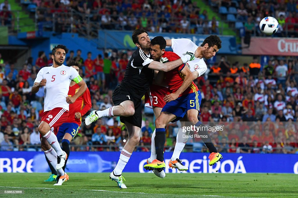 Sergio Busquets of Spain collides with the goalkeeper Revishvili of Georgia during an international friendly match between Spain and Georgia at...