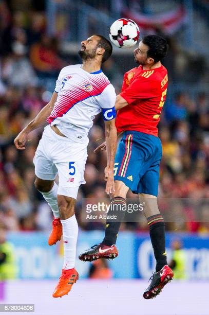 Sergio Busquets of Spain duels for the ball with Celso Borges of Costa Rica during the international friendly match between Spain and Costa Rica at...