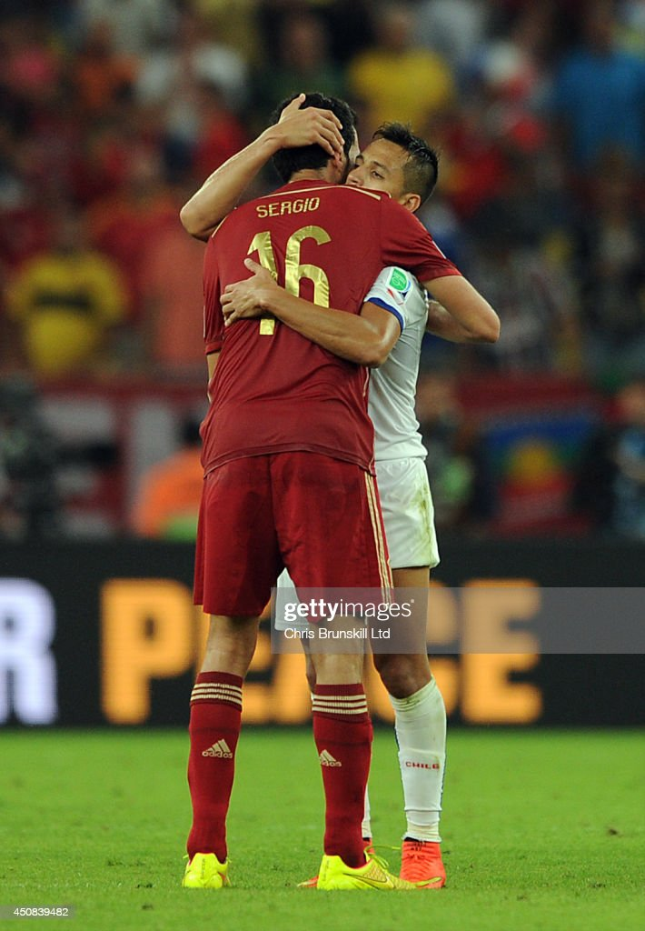 Sergio Busquets of Spain embraces Alexis Sanchez of Chile at full-time following the 2014 FIFA World Cup Brazil Group B match between Spain and Chile at Maracana Stadium on June 18, 2014 in Rio de Janeiro, Brazil.