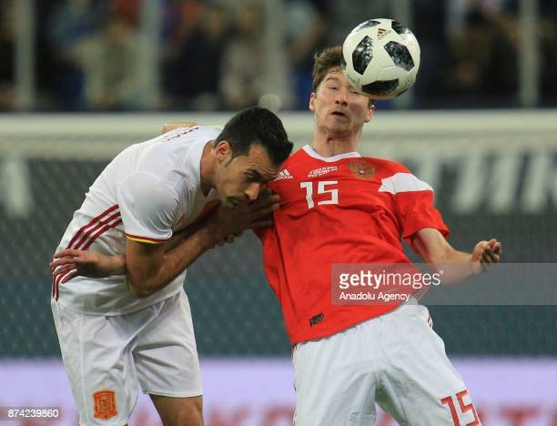 Sergio Busquets of Spain in action against Alexey Miranchuk of Russia during an international friendly football match between Russia and Spain at...
