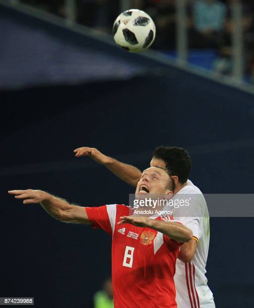 Sergio Busquets of Spain in action against Denis Glushakov of Russia during an international friendly football match between Russia and Spain at...