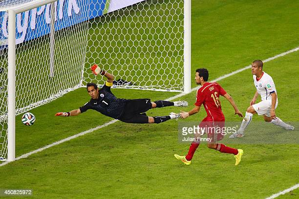 Sergio Busquets of Spain shoots and misses wide of the net against goalkeeper Claudio Bravo of Chile during the 2014 FIFA World Cup Brazil Group B...