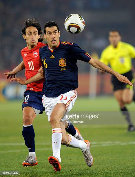 Sergio Busquets of Spain watches the ball next to Jorge Valdivia of Chile during the 2010 FIFA World Cup South Africa Group H match between Chile and...