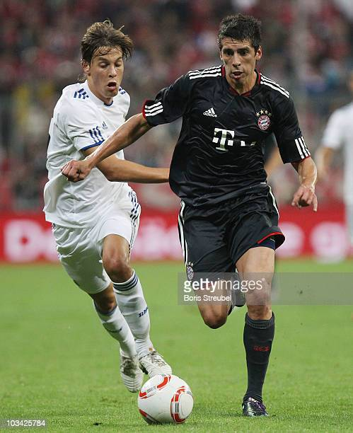 Sergio Canales of Real and Jose Ernesto Sosa of Bayern battle for the ball during the Franz Beckenbauer Farewell match between FC Bayern Muenchen and...