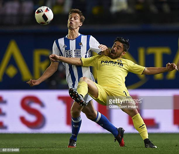 Sergio Canales of Real Sociedad competes for the ball with Jaume Costa of Villarreal during the Copa del Rey Round of 16 second leg match between...