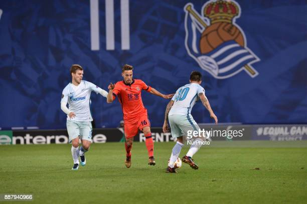 Sergio Canales of Real Sociedad duels for the ball with Matias Kranevitter of Zenit during the UEFA Europa League Group L football match between Real...
