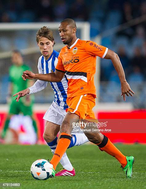Sergio Canales of Real Sociedad duels for the ball with Seydou Keita of Valencia CF during the La Liga match between Real Sociedad and Valencia CF at...