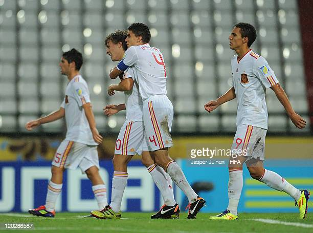 Sergio Canales of Spain celebrates scoring with his teammate Marc Bartra during the FIFA U20 World Cup Colombia 2011 group C match between Ecuador...