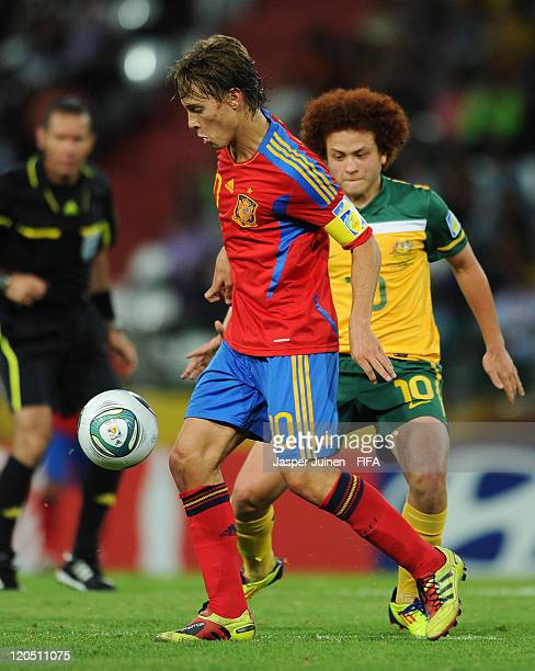 Sergio Canales of Spain shields Mustafa Amini of Australia from the ball during the FIFA U20 World Cup Colombia 2011 group C match between Australia...