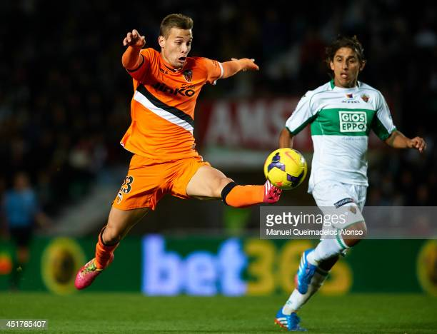 Sergio Canales of Valencia controls the ball next to Damian Suarez of Elche during the La Liga match between Elche FC and Valencia CF at Manuel...