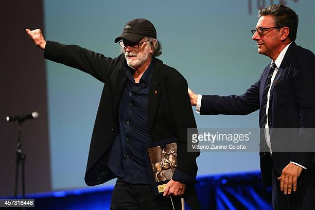 Sergio Castellitto and Tomas Milian attend the 'Opening Ceremony and Acting Award To Tomas Milian' during the 9th Rome Film Festival on October 16...