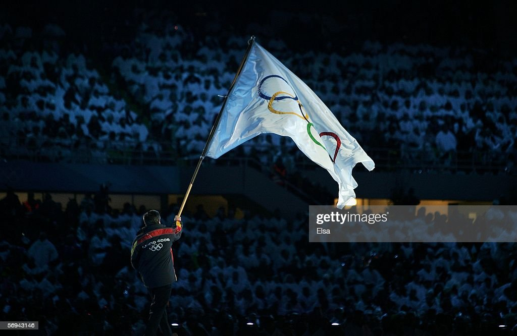 Sergio Chiamparino the mayor of Turin carries the Olympic flag during the Closing Ceremony of the Turin 2006 Winter Olympic Games on February 26 2006...