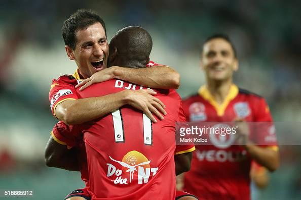 Sergio Cirio of Adelaide United congratulates Bruce Djite of Adelaide United as he celebrates scoring a goal during the round 26 ALeague match...