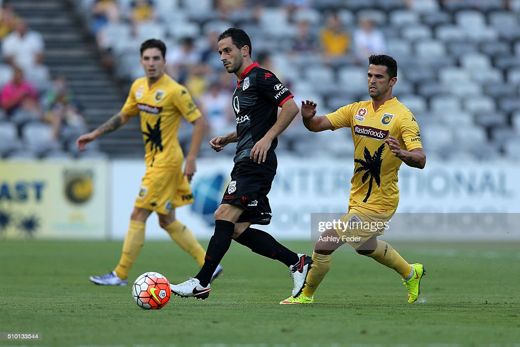 Sergio Cirio of Adelaide United controls the ball ahead of Fabio Ferreira of the Mariners during the round 19 A-League match between the Central Coast Mariners and Adelaide United at Central Coast Stadium on February 14, 2016 in Gosford, Australia.