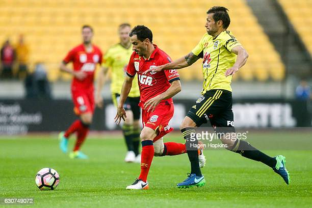 Sergio Cirio of Adelaide United evades the defence of Vince Lia of the Phoenix during the round 13 ALeague match between Wellington Phoenix and...