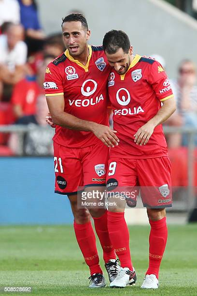 Sergio Cirio of Adelaide United is congratulated by teammate Tarek Elrich after he scored a goal during the round 18 ALeague match between Adelaide...