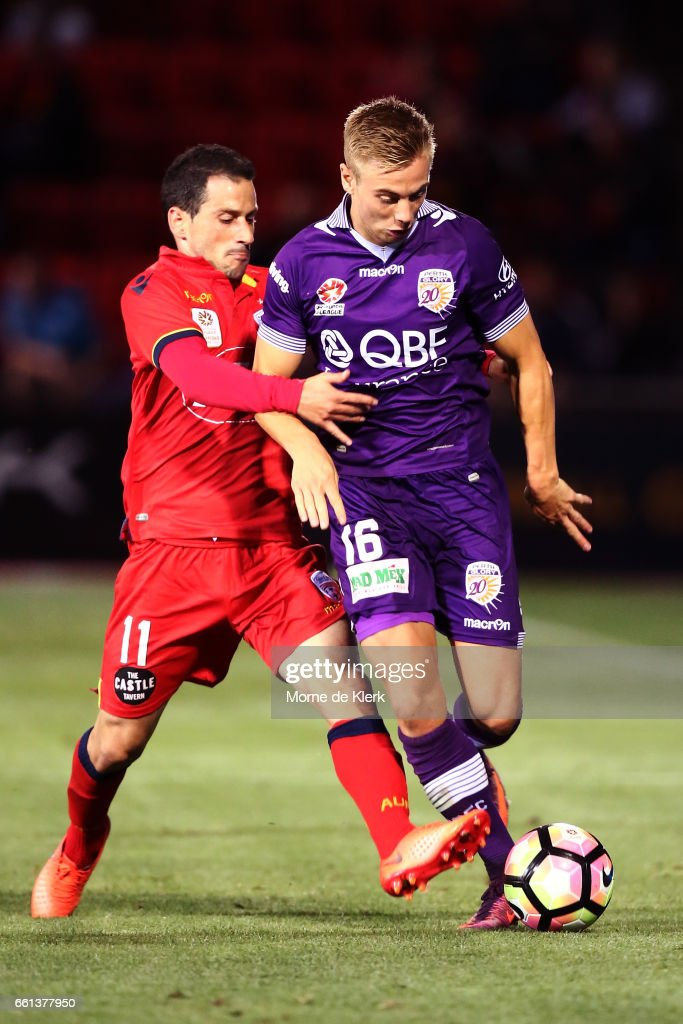 Sergio Cirio of Adelaide United tackles Joseph Mills of Perth Glory during the round 25 A-League match between Adelaide United and Perth Glory at Coopers Stadium on March 31, 2017 in Adelaide, Australia.