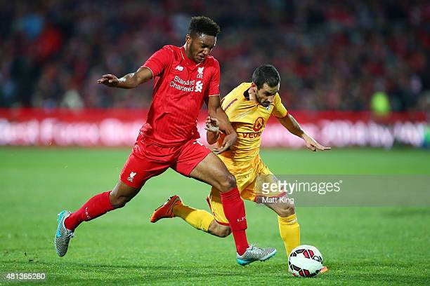 Sergio Cirio of United is challenged by Joe Gomez of Liverpool during the international friendly match between Adelaide United and Liverpool FC at...
