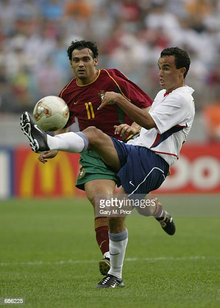 Sergio Conceicao of Portugal challenges Landon Donovan of USA during the first half of the Portugal v USA Group D World Cup Group Stage match played...