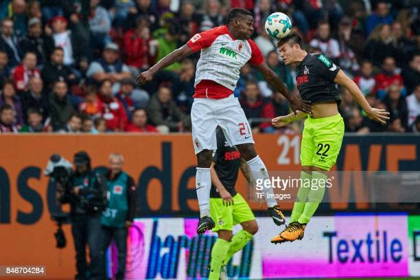 Sergio Cordova of Augsburg and Jorge Mere of Koeln battle for the ball during the Bundesliga match between FC Augsburg and 1 FC Koeln at WWKArena on...