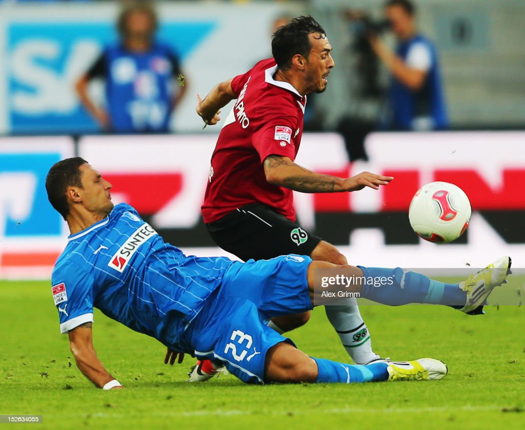 Sergio da Silva Pinto (back) of Hannover is challenged by Sejad Salihovic of Hoffenheim during the Bundesliga match between 1899 Hoffenheim and Hannover 96 at Rhein-Neckar-Arena on September 23, 2012 in Sinsheim, Germany.