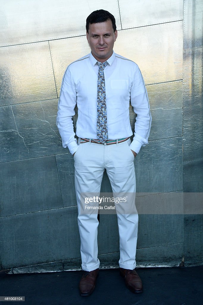 Sergio Davila poses at Sergio Davila Runway at New York Fashion Week Men's S/S 2016 at PHD at the Dream Downtown on July 16 2015 in New York City