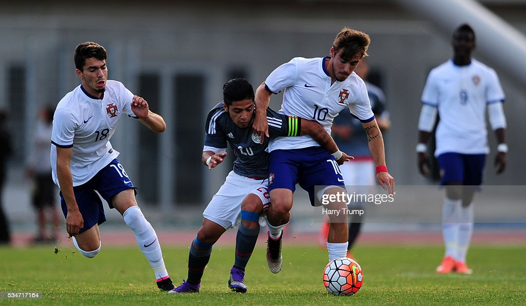 Sergio Diaz of Paraguay is tackled by Andre Horta of Portugal during the Toulon Tournament match between Portugal and Paraguay at the Stade Leo Lagrange on May 27, 2016 in Toulon, France.