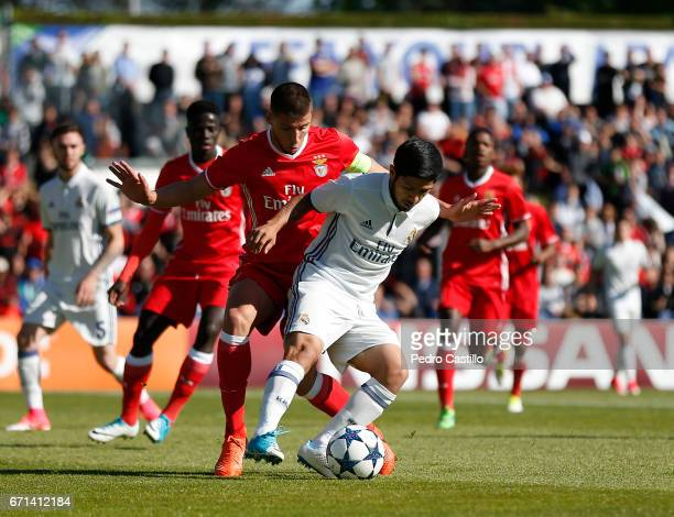 Sergio Diaz of Real Madrid duels for the ball with Ruben Dias of Benfica during the UEFA Youth League Final Four match between Real Madrid CF and...