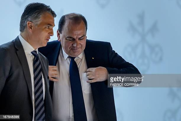 Sergio Ermotti and Axel Weber respectively CEO and chairman of Swiss banking giant UBS speak together during the group's annual shareholders meeting...