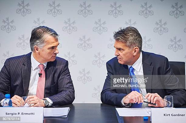 Sergio Ermotti CEO of Swiss banking giant UBS speaks to Kirt Gardner Group Chief Financial Officer before the presentation of UBS's fourth quarter...