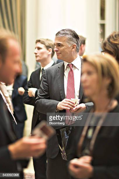 Sergio Ermotti chief executive officer of UBS AG center looks on in between sessions during the Swiss International Finance Forum in Bern Switzerland...