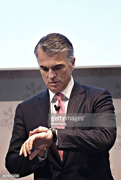 Sergio Ermotti chief executive officer of UBS AG checks his watch ahead of the full year results news conference in Zurich Switzerland on Tuesday Feb...