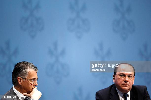 Sergio Ermotti chief executive officer of UBS AG left sits with Axel Weber chairman of UBS AG during the bank's annual general meeting in Zurich...