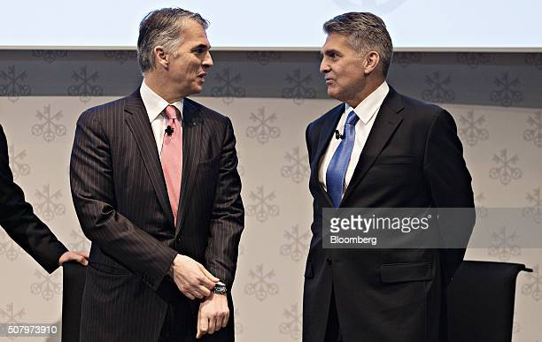 Sergio Ermotti chief executive officer of UBS AG left speaks with Kirt Gardner chief financial officer of UBS AG ahead of the full year results news...