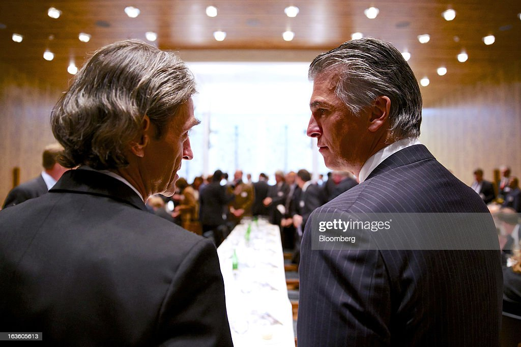 Sergio Ermotti, chief executive officer of UBS AG, right, listens to Thomas Knecht, chairman of the board of the Swiss-American Chamber of Commerce, prior to his keynote address at the Swiss-American Chamber of Commerce in Zurich, Switzerland, on Wednesday, March 13, 2013. Ermotti said U.S. regulations are a 'potential competitive disincentive for international groups.' Photographer: Gianluca Colla/Bloomberg via Getty Images