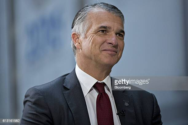 Sergio Ermotti chief executive officer of UBS AG smiles at the end of a Bloomberg Television interview at the International Monetary Fund and World...