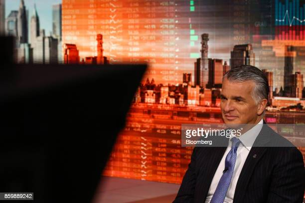 Sergio Ermotti chief executive officer of UBS Group AG listens during a Bloomberg Television interview in New York US on Tuesday Oct 10 2017...