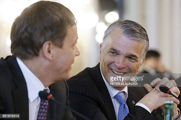 Sergio Ermotti UBS CEO and Alexandre Zeller chairman of Credit Suisse AG talk during a business roundtable of Swiss business leaders with China's...