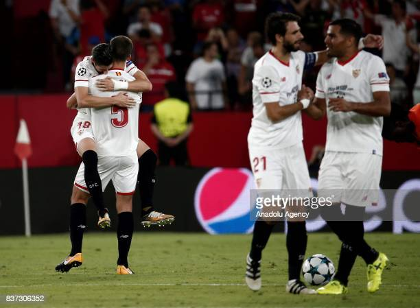 Sergio Escudero and Clement Lenglet of Sevilla celebrate after scoring a goal during the UEFA Champions League playoff match between Sevilla and...