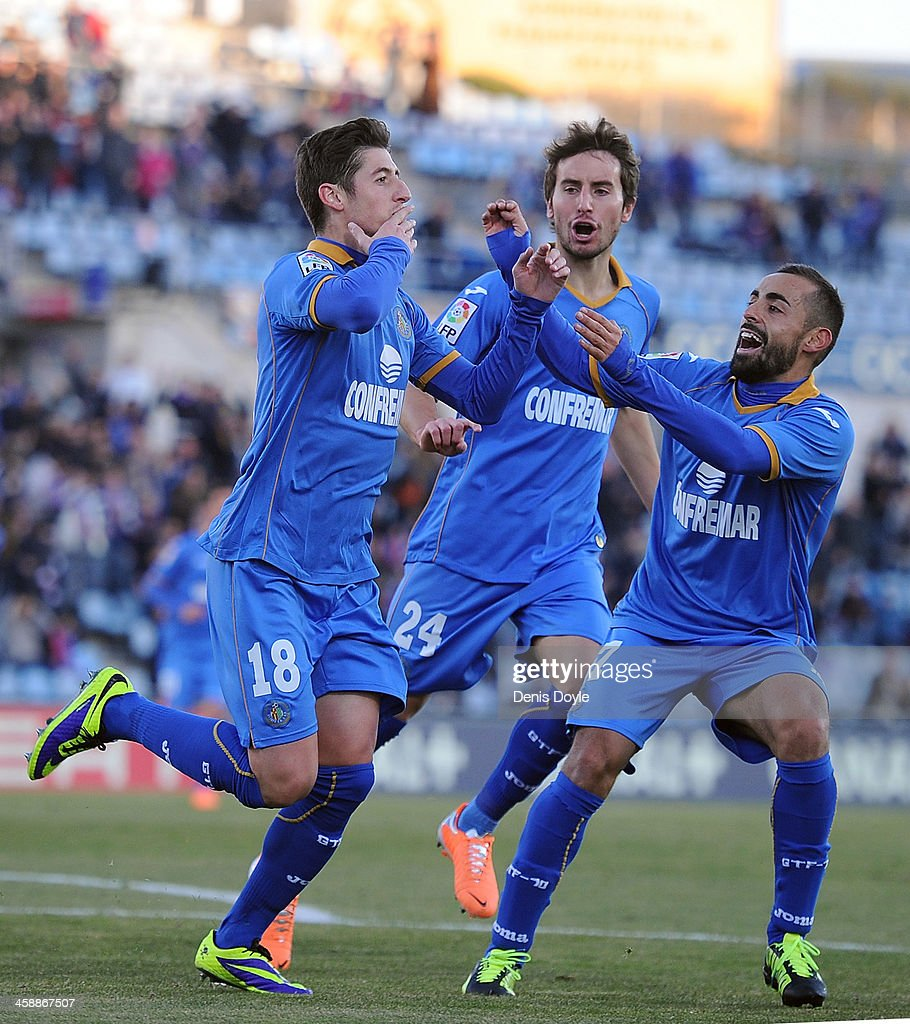 Sergio Escudero (#18) of Getafe CF celebrates with <a gi-track='captionPersonalityLinkClicked' href=/galleries/search?phrase=Angel+Lafita&family=editorial&specificpeople=4089105 ng-click='$event.stopPropagation()'>Angel Lafita</a> (R) after scoring Getafe's first goal during the La Liga match between Getafe CF and FC Barcelona at Coliseum Alfonso Perez on December 22, 2013 in Getafe, Spain.