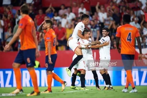 Sergio Escudero of Sevilla FC celebrates after scoring with his team mates Wissam Ben Yedder Joaquin Correa and Ever Banega during the UEFA Champions...