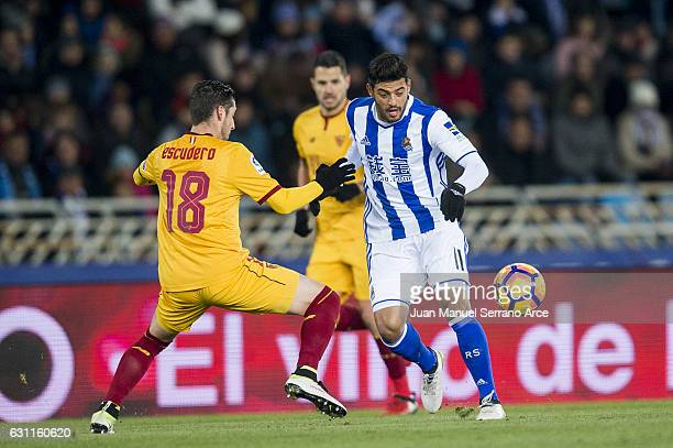 Sergio Escudero of Sevilla FC duels for the ball with Carlos Vela of Real Sociedad during the La Liga match between Real Sociedad de Futbol and...