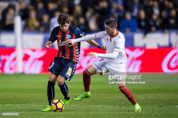 Sergio Escudero of Sevilla FC duels for the ball with Oscar Romero of Deportivo Alaves during the La Liga match between Deportivo Alaves and Sevilla...