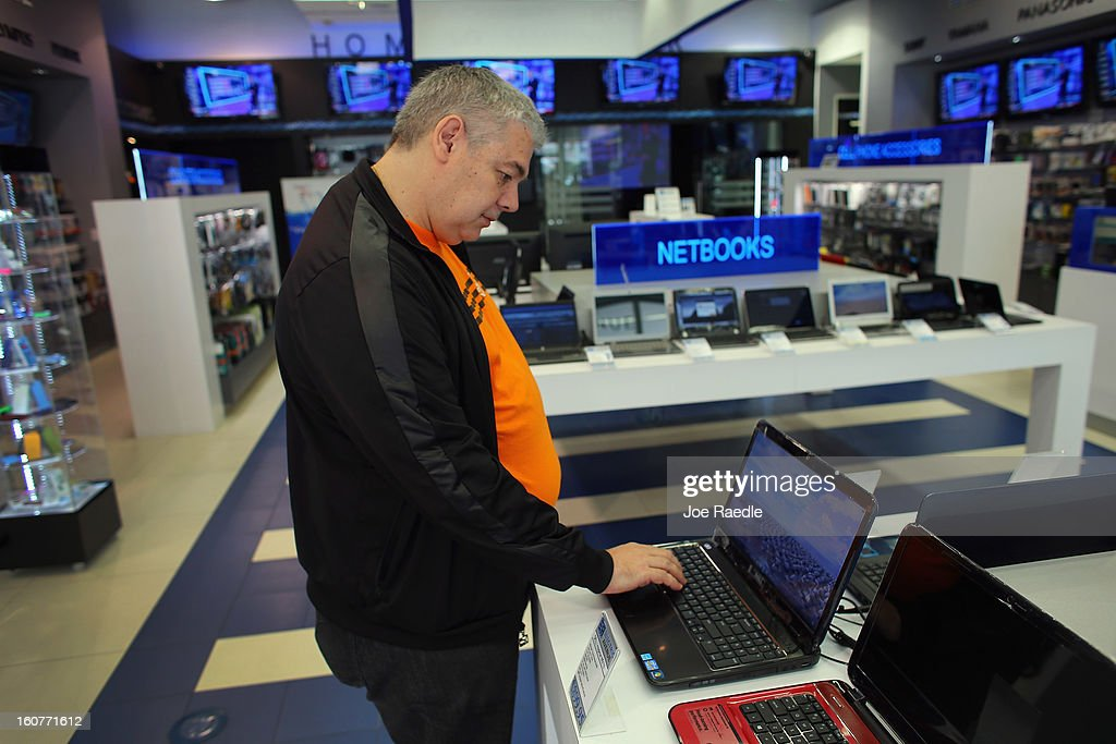 Sergio Feldman checks out a Dell computer on display at the Electric Avenue store on February 5, 2013 in Miami, Florida. Dell Inc. today announced it will be taken private in a deal valued at about $24.4 billion. The company will be acquired by Dell founder and Chief Executive Michael S. Dell and global technology investment firm Silver Lake and Microsoft Corp. will invest $2 billion in the deal.