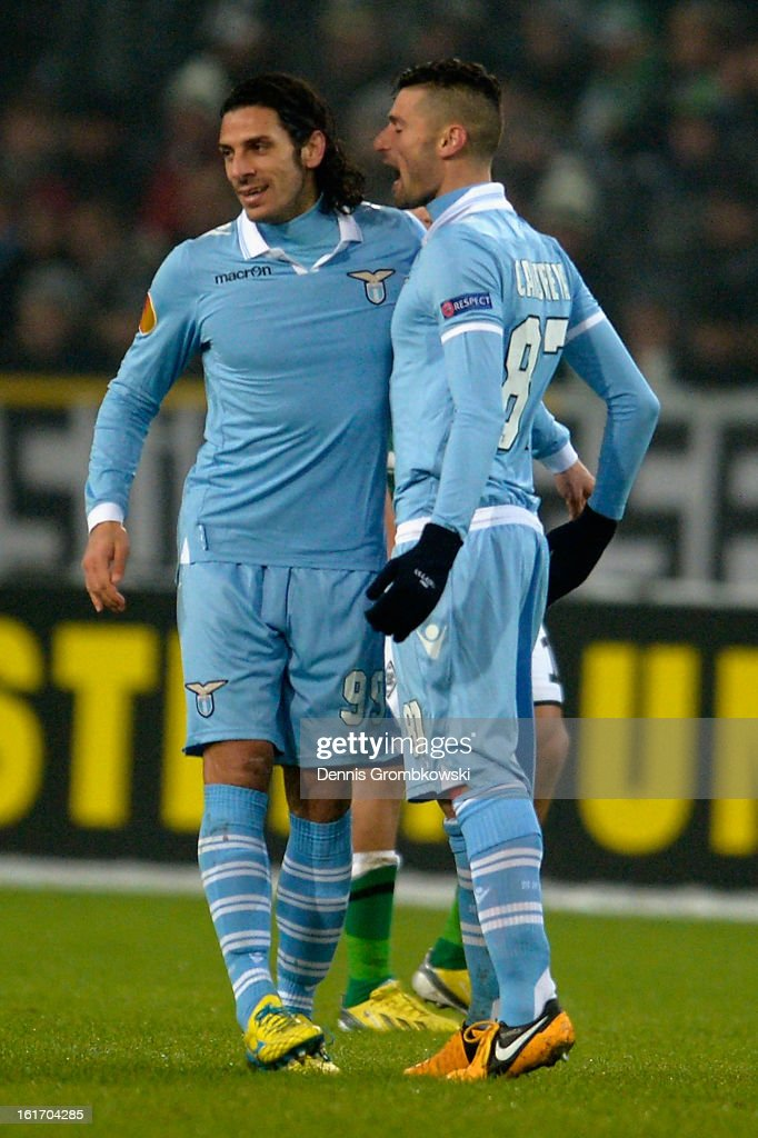 Sergio Flaccori of Lazio celebrates with teammate <a gi-track='captionPersonalityLinkClicked' href=/galleries/search?phrase=Antonio+Candreva&family=editorial&specificpeople=4063716 ng-click='$event.stopPropagation()'>Antonio Candreva</a> after scoring his team's first goal during the UEFA Europa League round of 32 first leg match between VfL Borussia Moenchengladbach and S.S. Lazio at Borussia Park Stadium on February 14, 2013 in Moenchengladbach, Germany.