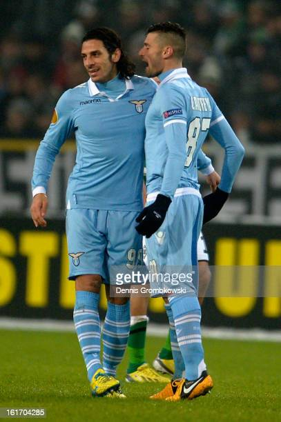 Sergio Flaccori of Lazio celebrates with teammate Antonio Candreva after scoring his team's first goal during the UEFA Europa League round of 32...