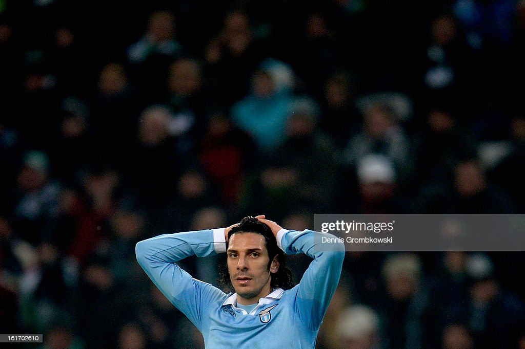 <a gi-track='captionPersonalityLinkClicked' href=/galleries/search?phrase=Sergio+Floccari&family=editorial&specificpeople=675401 ng-click='$event.stopPropagation()'>Sergio Floccari</a> of Lazio reacts during the UEFA Europa League round of 32 first leg match between VfL Borussia Moenchengladbach and S.S. Lazio at Borussia Park Stadium on February 14, 2013 in Moenchengladbach, Germany.