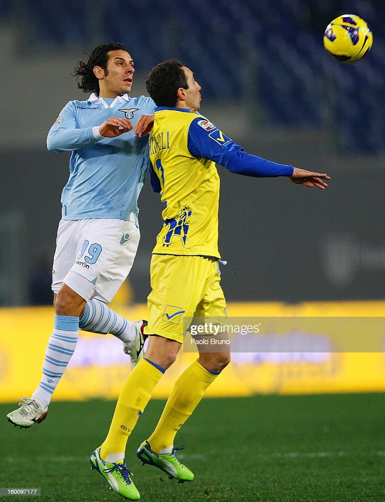 Sergio Floccari (L) of S.S. Lazio competes for the ball with Dario Dainelli of AC Chievo during the Serie A match between S.S. Lazio and AC Chievo Verona at Stadio Olimpico on January 26, 2013 in Rome, Italy.