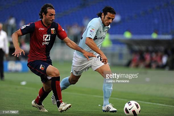 Sergio Floccari of SS Lazio competes with Emiliano Moretti of Genoa CFC during the Serie A match between SS Lazio and Genoa CFC at Stadio Olimpico on...