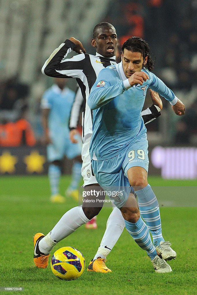 Sergio Floccari (R) of S.S. Lazio in action against Paul Pogba of Juventus FC during the TIM cup match between Juventus FC and S.S. Lazio at Juventus Arena on January 22, 2013 in Turin, Italy.
